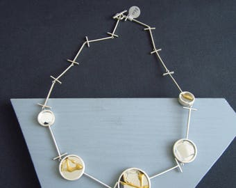 Healing cycle small. Geometric Necklace shows broken and healed mirrors, connected with T links. Using Kintsugi in recycled silver