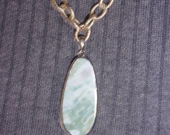 """Light green marbled oval pendant on a 21"""" textured rollo chain."""