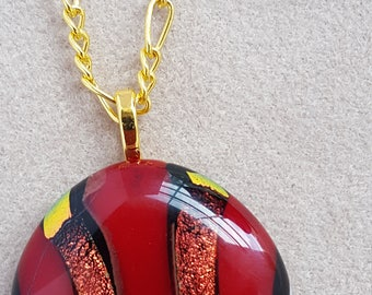 Red and Copper dichroic pendant with stones in the chain