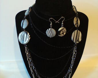 Black & White 2 Pc. Costume Jewelry Set Color may differ due to different monitors and or screens.