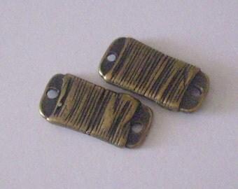 Metal in-between 2 bronze 15 x 7 x 2 mm