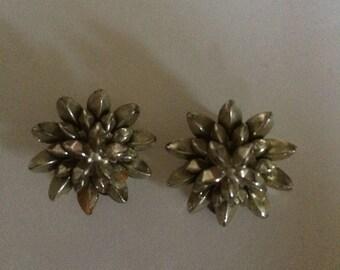 Plastic white flower clip on earrings