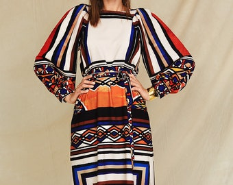 The dress straight with lush sleeves.