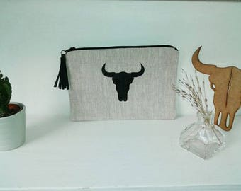Pouch / clutch in linen with leather tassel Buffalo head