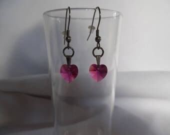 Fuchsia Swarovski hearts on stainless steel earrings.