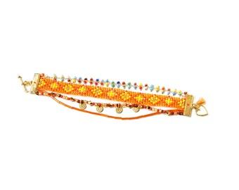 Shaman - Cuff gold and orange inspired multibracelets Brazil