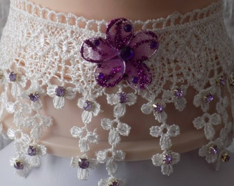 Crew neck white lace flowers, purple and silver rhinestone beads, purple colored organza flower.