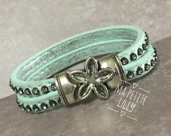 Pastel blue leather with a nice magnetic closure bracelet