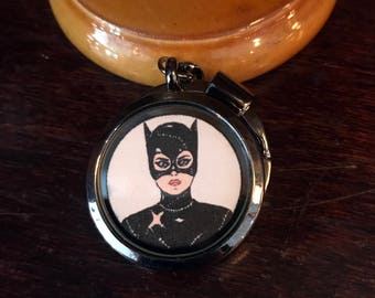 Catwoman/Selina Kyle Magnetic Keychain Locket. Open locket to unmask Catwoman!