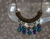 Beaded necklace with chandelier component