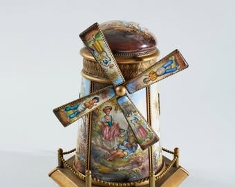 A gilt metal mounted Vienna enamel music box and cover