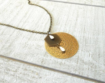 Bronze necklace, gold print and drip glazed white