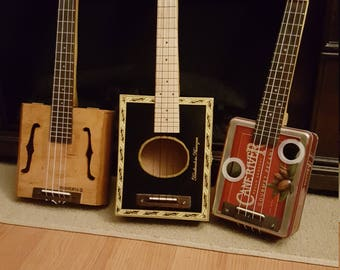 ukuleles made from cigar boxes or candy/cookie tins