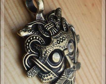 Bronze viking mask pendant with rune