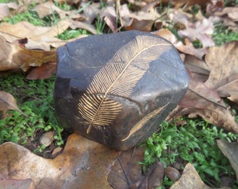 Hand carved black river rock feather pattern