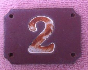 Red sandstone door number