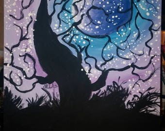 Silhouette of a Cherry Blossom Tree with the Full Moon in a pretty  Shade of Purple lighting up the night sky into a glowing Pink Haze.