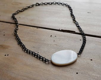 Pendant with account detail in nacre-type finish