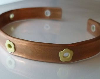 Queen Daisy copper bracelet 3/8 inches wide, with yellow flowers along the band