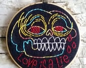 "rainbow LOVE IS a LIE skull - 5"" hand embroidered wall hanging"