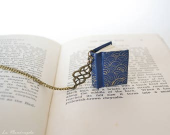 Gold Blue Book Necklace. Miniature blue book with gold swirls. Necklace for book lovers
