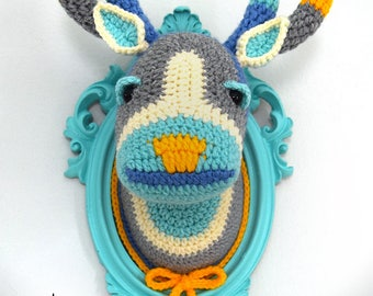 Crochet color block deer head in a light turquoise frame.