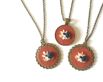Floral Pendant in Rust | hand embroidered necklace, bouquet, rust, pink, navy