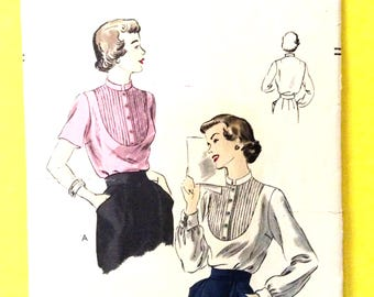Vogue 6628 Early 1950s Tuck-in blouse has deep shirt-bosom yoke, stand-up collar French cuffs Vintage Sewing Pattern  Bust 30