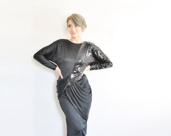 1980 black sequin cocktail dress to the max . asymmetric drapes and sleeves .medium