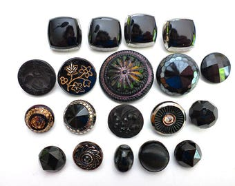 Nineteen Black Glass Shank Buttons