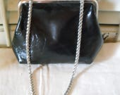 Vintage Small Black Purse With Shoulder Chain from Unlisted Soft Leather Like Outside Inside Black Taffeta With Pocket
