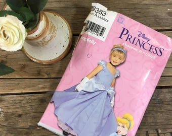 Disney Princess dress pattern cut to Size 7, English and Spanish instructions