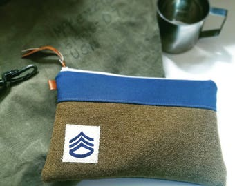 U-pcycled, olive green army blanket clutch/Vintage fabric patch/Navy blue canvas/White zipper/Caramel brown vegan leather details