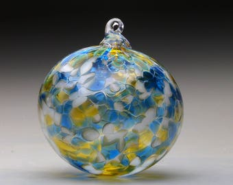 Hand made blown glass Christmas ornament in tones of gold, blue and sand, rhapsody