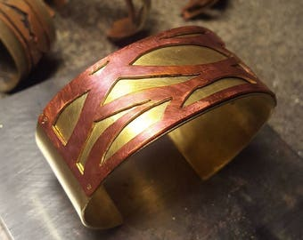 Energy cuff, copper and brass