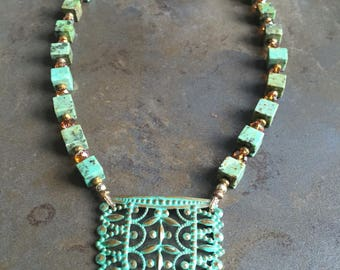 27 - German metal stamping, turquoise and Swarovski crystals necklace
