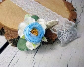Wedding boutonniere with pastel blue peony ranunculus white hydrangea greenery cold green silk flowers dusty miller elegant fresh summer