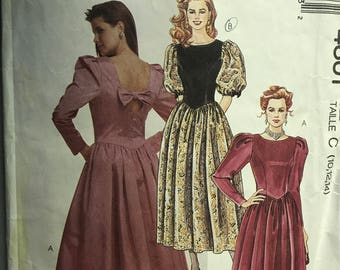 McCalls 4601 - 1980s Party Dress with Princess Seams, U Neckline, and Short Puff or Leg of Mutton Styled Sleeves - Size 10 12 14