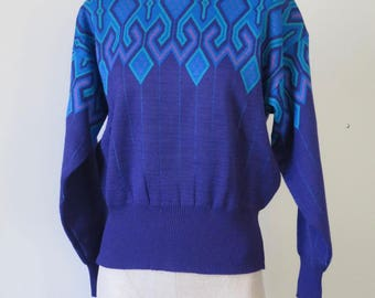 Amazing 70s 80s Meister women's wool blend sweater, made in Hong Kong. Purple, blue, turquoise and pink geometric design. Size Medium.