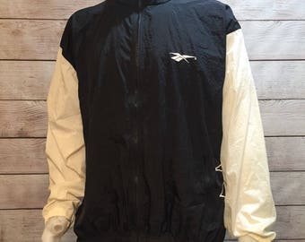 Vintage Reebok Windbreaker Jacket with Large Logo and Hide a way Hood