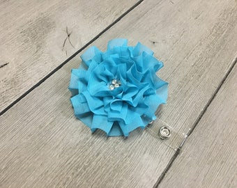 Turquoise ruffled flower retractable ID badge reel with slide clip