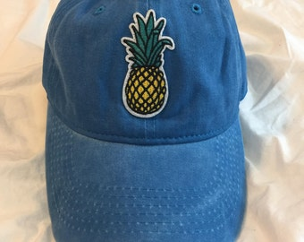 Distressed blue baseball cap with pineapple patch