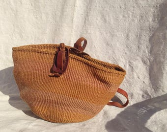 Vintage incredible Hand-woven Market Bag with beautiful hand-carved wooden adjustment fasten. Bronze and Blush stripe