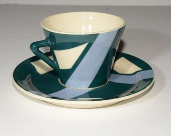 Teacup and saucer,off-white, green, blue,artist, pottery, art deco,ceramic, farmhouse, stamped, Martine Buczkowski, Jacques Tétreault,Quebec