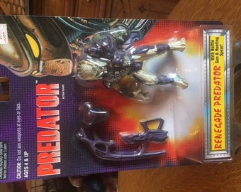 vintage predator toy sealed in bubble
