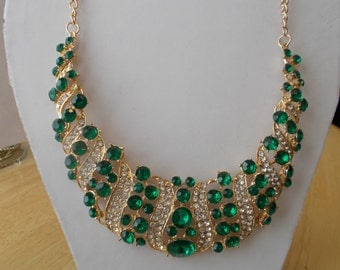 Gold Tone Bib Necklace with Green Crystal Beads and Clear Rhinestones on a Gold Tone Chain