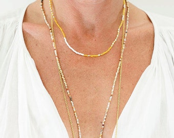 short yellow and white beaded necklace