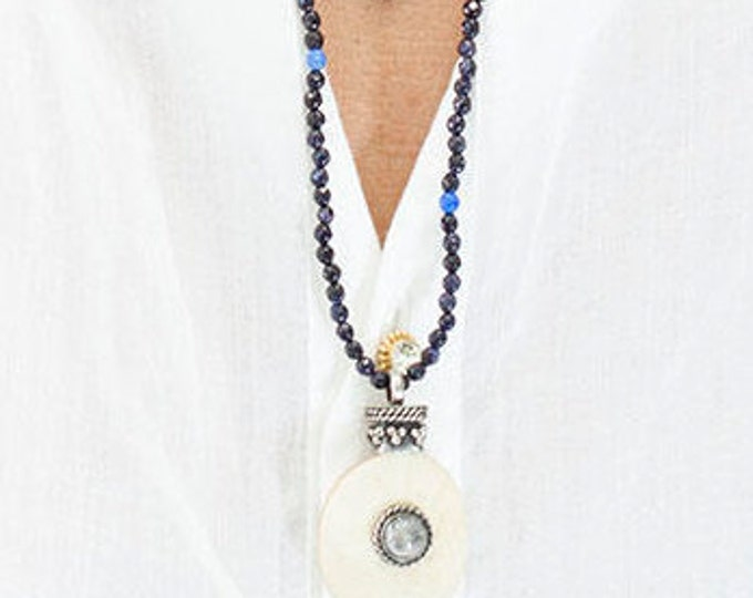 Necklace with a horn pendant