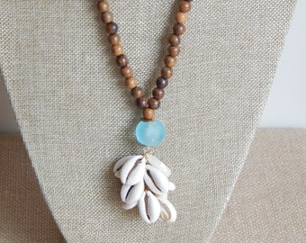Cowrie tassel necklace with aqua blue recycled glass, layering necklace, beach boho jewelry, boho style, coastal chic, dark wood beads