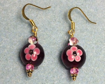 Dark red and pink lampwork turtle bead earrings adorned with pink Chinese crystal beads.